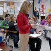 Photo -      Teacher Carrie Hixon talks with student Miranda McKee during Hixon's financial literacy class at Mustang High School in Mustang. . Students in the state of Oklahoma are required to take the class in order to graduate. Photo by Chris Landsberger, The Oklahoman   CHRIS LANDSBERGER -  CHRIS LANDSBERGER