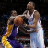 Oklahoma City\'s Kevin Durant (35) is fouled by Earl Clark (6) during an NBA basketball game between the Oklahoma City Thunder and the Los Angeles Lakers at Chesapeake Energy Arena in Oklahoma City, Tuesday, March. 5, 2013. Photo by Bryan Terry, The Oklahoman