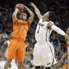 Oklahoma\'s Cezar Guerrero (1) shoots as Missouri\'s Phil Pressey (1) defends during the Big 12 tournament men\'s basketball game between the Oklahoma State Cowboys and Missouri Tigers the Sprint Center, Thursday, March 8, 2012. Photo by Sarah Phipps, The Oklahoman