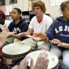 Skylar Parker (right) joins Cole Peak (center), Glen Braxton and other students as they play African drums during music class at Independence Charter Middle School in Oklahoma City on Monday, April 20, 2009. Photo by John Clanton, The Oklahoman