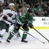 Photo - Dallas Stars' Aaron Rome (27) controls the puck in front of Minnesota Wild's Kyle Brodziak (21) in the second period of an NHL hockey game, Tuesday, Jan. 21, 2014, in Dallas. (AP Photo/Tony Gutierrez)