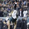 New Orleans Saints\' Drew Brees, left, tries to pass as Philadelphia Eagles\' Connor Barwin, center, is upended by Darren Sproles during the second half of an NFL wild-card playoff football game, Saturday, Jan. 4, 2014, in Philadelphia. (AP Photo/Matt Rourke)