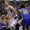 Dallas Mavericks forward Dirk Nowitzki (41) of Germany drives against Golden State Warriors Draymond Green (23) during the second half of an NBA basketball game Saturday, Feb. 9, 2013, in Dallas. The Mavericks won 116-91. (AP Photo/LM Otero)