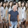 Photo -   Italian fashion designer Giorgio Armani poses with models after presenting his Emporio Armani Women's Spring-Summer 2013 fashion collection, during the fashion week in Milan, Italy, Thursday, Sept. 20, 2012. (AP Photo/Antonio Calanni)