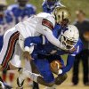 Millwood\'s Dametric Sanders is brought down by Lincoln Christian\'s Austin Grauer during a Class 2A high school football playoff game between Millwood and Lincoln Christian in Oklahoma City, Friday, Nov. 25, 2011. Photo by Bryan Terry, The Oklahoman
