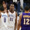 Oklahoma City\'s Kevin Durant (35) and Russell Westbrook (0) slap hands near Shannon Brown (12) of Los Angeles after a play during the NBA basketball game between the Los Angeles Lakers and the Oklahoma City Thunder at the Ford Center in Oklahoma City, Friday, March 26, 2010. Oklahoma City won, 91-75. Photo by Nate Billings, The Oklahoman