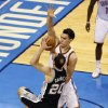 Oklahoma City\'s Steven Adams (12) defends as San Antonio\'s Manu Ginobili (20) drives to the basket during Game 6 of the Western Conference Finals in the NBA playoffs between the Oklahoma City Thunder and the San Antonio Spurs at Chesapeake Energy Arena in Oklahoma City, Saturday, May 31, 2014. Photo by Nate Billings, The Oklahoman