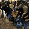 Riot police clash with protestors during a demonstration against corruption in Madrid, Spain, Saturday, Feb. 2, 2013. Spain\'s prime minister promised Saturday to publicly disclose the amount of funds in all his personal bank accounts, denying recent media reports that allege he and members of his governing Popular Party accepted or made under-the-table payments. (AP Photo/Andres Kudacki)