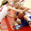 Erick\'s Maranda Janz (11), left, and Hammon\'s Lexie Brown (20) battle for a loose ball during a Class B girls high school basketball area playoff game between Erick and Hammon at Yukon High School in Yukon, Okla., Friday, Feb. 24, 2012. Photo by Nate Billings, The Oklahoman