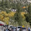 Photo - A Flight for Life Helicopter rises above backed up traffic Monday Sept. 30, 2013,  in south-central Colorado.  Roads were closed as emergency personnel work to  aid hikers trapped after a rock slide on the trail to Agnes Vaille Falls.   (AP Photo/The Mountain Mail, James Redmond)