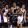 Oklahoma City Thunder\'s Thabo Sefolosha (2) splits defenders Shannon Brown (26) and Goran Dragic (1) as the Oklahoma City Thunder play the Phoenix Suns in NBA basketball at the Chesapeake Energy Arena in Oklahoma City, on Monday, Dec. 31, 2012. Photo by Steve Sisney, The Oklahoman