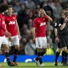 Photo - Manchester United's interim manager Ryan Giggs, centre right, smiles after his team's English Premier League soccer match against Hull City,  at Old Trafford Stadium, Manchester, England, Tuesday May 6, 2014. (AP Photo/Jon Super)