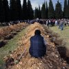 Rows of open graves for the mine accident victims are seen in Soma, Turkey, Wednesday, May 14, 2014. A violent protest erupted Wednesday in the Turkish city of Soma, where at least 238 coal miners have died after a mine explosion. Many in the crowd expressed anger at Prime Minister Recep Tayyip Erdogan\'s government. Rocks were being thrown and some people were shouting that Erdogan was a