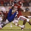 OU\'s Lamar Harris (15) and Jaydan Bird (44) bring down KU\'s James Sims (29) during the college football game between the University of Oklahoma Sooners (OU) and the University of Kansas Jayhawks (KU) at Gaylord Family-Oklahoma Memorial Stadium on Saturday, Oct. 20th, 2012, in Norman, Okla. Photo by Chris Landsberger, The Oklahoman