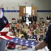 Terry Farmer and Harmon Thompson, members of Veteran\'s School Flag Program, demonstrate the proper way to fold an American flag to the students at Prairie Vale Elementary School, Thursday, March 15, 2012. Photo By David McDaniel/The Oklahomen