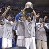 Oklahoma City\'s Kevin Durant, Serge Ibaka, Russell Westbrook and Reggie Jackson, from left, celebrate with the Western Conference Championship Trophy during Game 6 of the Western Conference Finals between the Oklahoma City Thunder and the San Antonio Spurs in the NBA playoffs at the Chesapeake Energy Arena in Oklahoma City, Wednesday, June 6, 2012. Photo by Chris Landsberger, The Oklahoman
