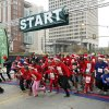 Children and their parents begin the fun run of the SandRidge Santa Run in downtown Oklahoma City, OK, Saturday, December 8, 2012, By Paul Hellstern, The Oklahoman