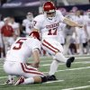 Oklahoma\'s Jimmy Stevens (17) kicks the game winning field goal to put the Sooners up 23-20 over Nebraska during the Big 12 football championship game between the University of Oklahoma Sooners (OU) and the University of Nebraska Cornhuskers (NU) at Cowboys Stadium on Saturday, Dec. 4, 2010, in Arlington, Texas. Photo by Chris Landsberger, The Oklahoman