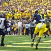 Photo - Michigan wide receiver Devin Funchess (1) makes a reception for a touchdown in the first quarter of an NCAA college football game against Appalachian State in Ann Arbor, Mich., Saturday, Aug. 30, 2014. (AP Photo/Tony Ding)