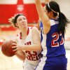 Erick\'s Hannah Millar (33) tries to score past Hammon\'s Peyton Walker (23) during a Class B girls high school basketball area playoff game between Erick and Hammon at Yukon High School in Yukon, Okla., Friday, Feb. 24, 2012. Photo by Nate Billings, The Oklahoman
