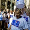 Photo - Major League Baseball Executive Vice President of Baseball Operations Joe Torre participates in the ALS Ice-Bucket Challenge outside the organization's headquarters in New York, Wednesday, Aug. 20, 2014. Torre participated with more than 160 other MLB employees to raise more than $16,000 for the ALS Association. (AP Photo/Vanessa A. Alvarez)