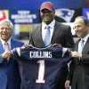 New England Patriots owner Robert Kraft, left, and team president Jonathan Kraft, right, present Jamie Collins, center, with a jersey representing the team's first pick of the 2013 NFL draft at Gillette Stadium, in Foxborough, Mass., Thursday, May 2, 2013. The Patriots took Collins with the 52nd overall pick, after coach Bill Belichick privately worked out for him. (AP Photo/Steven Senne)