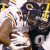 Photo - Chicago Bears running back Matt Forte (22) is hit by Pittsburgh Steelers defensive end Brett Keisel (99) in the first quarter of an NFL football game on Sunday, Sept. 22, 2013, in Pittsburgh. (AP Photo/Keith Srakocic)