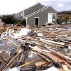 Debris floats around a house pushed off it\'s foundation in the aftermath of superstorm Sandy in East Haven, Conn., Tuesday, Oct. 30, 2012. Sandy, the storm that made landfall Monday, caused multiple fatalities, halted mass transit and cut power to more than 6 million homes and businesses. (AP Photo/Jessica Hill) ORG XMIT: CTJH111