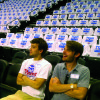 Blake deBernard and Ethan Sperle, members of Quail Springs Baptist Church, rest after prayer walking as they placed Oklahoma City Thunder playoff T-shirts on seats at the Chesapeake Energy Arena. Photo provided by The Baptist Messenger