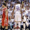 Oklahoma City\'s Kevin Durant (35) and Russell Westbrook (0) celebrate next to Houston\'s Carlos Delfino (10) during Game 2 in the first round of the NBA playoffs between the Oklahoma City Thunder and the Houston Rockets at Chesapeake Energy Arena in Oklahoma City, Wednesday, April 24, 2013. Photo by Chris Landsberger, The Oklahoman