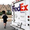 Longtime FedEx driver Ray Beltrane delivers packages to home in northwest Oklahoma City on Monday, Dec. 12, 2011. Photo by Jim Beckel, The Oklahoman