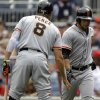 Photo - San Francisco Giants' Gregor Blanco, right, celebrates his solo home run with teammate Hunter Pence (8) during the first inning of a baseball game, Sunday, Aug. 24, 2014, in Washington. (AP Photo/Luis M. Alvarez)