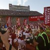 The Oklahoma team takes the field before the college football game between the University of Oklahoma Sooners (OU) and the Kansas Jayhawks (KU) at Gaylord Family-Oklahoma Memorial Stadium in Norman, Okla., Saturday, Oct. 20, 2012. Photo by Bryan Terry, The Oklahoman