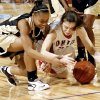 Midwest City High School\'s Iesha Simmons, left, and Tulsa Union High School\'s Andrea Stucky (35) go after a loose ball during the girls class 6A semifinals game at the Ford Center on Friday, March 7, 2008, in Oklahoma City, Okla. BY CHRIS LANDSBERGER, THE OKLAHOMAN