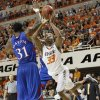 Oklahoma State \'s Marcus Smart (33) shoots over Kansas\' Jamari Traylor (31) during the college basketball game between the Oklahoma State University Cowboys (OSU) and the University of Kanas Jayhawks (KU) at Gallagher-Iba Arena on Wednesday, Feb. 20, 2013, in Stillwater, Okla. Photo by Chris Landsberger, The Oklahoman