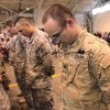 Soldiers bow their heads as they silently recall the ultimate sacrifices made by their fellow soldiers who were killed while the unit was deployed overseas. their When 84 Oklahoma Army National Guard troops marched into the hangar at the Air National Guard base in southwest Oklahoma City Saturday morning, April 7, 2012, about 350 people, mostly family and friends, gave them a rousing and enthusiastic welcome. Their homecoming celebration marked the final return of soldiers with the 45th who had been deployed to Iraq and Afghanistan. Photo by Jim Beckel, The Oklahoman