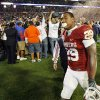 OU\'s Chris Brown (29) walks off the field as photographers swarm Florida players after the BCS National Championship college football game between the University of Oklahoma Sooners (OU) and the University of Florida Gators (UF) on Thursday, Jan. 8, 2009, at Dolphin Stadium in Miami Gardens, Fla. The Florida Gators won, 24-14. PHOTO BY NATE BILLINGS, THE OKLAHOMAN