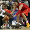 United States\' LeBron James and Spain\'s Pau Gasol battle for a loose ball during the men\'s gold medal basketball game at the 2012 Summer Olympics, Sunday, Aug. 12, 2012, in London. (AP Photo/Charles Krupa)