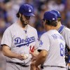 Photo - Los Angeles Dodgers pitcher Dan Haren (14) hands the ball to manager Don Mattingly (8) as he leaves the mound in the fifth inning of a baseball game against the Kansas City Royals at Kauffman Stadium in Kansas City, Mo., Wednesday, June 25, 2014. (AP Photo/Colin E. Braley)