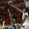 Oklahoma State wing Le\'Bryan Nash (2) blocks a shot by Mississippi Valley State guard Anthony McDonald (24) in the first half of an NCAA college basketball game in Stillwater, Okla., Friday, Nov. 8, 2013. (AP Photo/Sue Ogrocki)