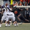 Oklahoma State\'s Nigel Nicholas (89) forces TCU\'s Trevone Boykin (2) to turn the ball over during a college football game between Oklahoma State University (OSU) and Texas Christian University (TCU) at Boone Pickens Stadium in Stillwater, Okla., Saturday, Oct. 27, 2012. Photo by Sarah Phipps, The Oklahoman