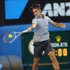 Photo - Switzerland's Roger Federer hits a forehand return to Russia's Nikolay Davydenko during their second round match at the Australian Open tennis championship in Melbourne, Australia, Thursday, Jan. 17, 2013. (AP Photo/Andrew Brownbill)