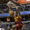 Cleveland Cavaliers forward Alonzo Gee dunks in front of Washington Wizards forward Martell Webster in the first half of an NBA basketball game, Wednesday, Dec. 26, 2012, in Washington. (AP Photo/Alex Brandon)