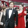 In this Feb. 24, 2008 file photo, actress Anne Hathaway, right, walks the red carpet with her then-boyfriend Raffaello Follieri, at the Kodak Theater for the 80th Academy Awards in Los Angeles. Follieri was released Friday morning from a prison in Loretto, 80 miles east of Pittsburgh. Follieri pleaded guilty to cheating investors by falsely claiming he had Vatican connections that enabled him to buy church property at a discount. He was sentenced in 2008 to 4 1/2 years in prison. Follieri agrees he owes more than $3.6 million to those he ripped off. The proceeds supported a playboy lifestyle that included a $37,000-a-month New York City apartment and lavish vacations with the star of