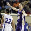 Okarche\'s Randi Hufnagel celebrates in front of Chattanooga\'s Missy Stallcup the Class A girl\'s semi final game between Chattanooga and Okarche at the State Fair Arena in Oklahoma City, Friday, March 2, 2012. Photo by Sarah Phipps, The Oklahoman