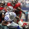 Dallas Cowboys running back DeMarco Murray (29) is taken down by Tampa Bay Buccaneers defensive end Adrian Clayborn (94) during the first half of an NFL football game, Sunday, Sept. 23, 2012, in Arlington, Texas. (AP Photo/Tony Gutierrez)