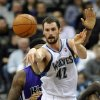 FILE - In this Jan. 16, 2012, file photo, Minnesota Timberwolves\' Kevin Love pass the ball during the second half of an NBA basketball game against the Sacramento Kings in Minneapolis. Love will miss the next six to eight weeks after breaking his right hand in a workout on Wednesday, Oct. 17, 2012. (AP Photo/ Jim Mone, File)