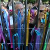 Photo -   People attach ribbons with Jewish names onto the fence of a former Jewish orphanage, in Warsaw, Poland, Sunday, July 22, 2012, during commemorations marking the 70th anniversary of first transport of Jews from the Warsaw Ghetto to the Treblinka death camp during World War II. ( AP Photo/Alik Keplicz)