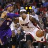 Phoenix Suns\' Michael Bealsey (0) tries to block Miami Heat\'s LeBron James (6) during the first half of an NBA basketball game in Miami, Monday, Nov. 5, 2012. (AP Photo/J Pat Carter)