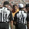 Tampa Bay Buccaneers head coach Greg Schiano yells at officials, including head linesman Ed Camp (134) and referee Jerome Boger (23) after a penalty during the fourth quarter of an NFL football game against the New Orleans Saints Sunday, Oct. 21, 2012, in Tampa, Fla. (AP Photo/Chris O\'Meara)